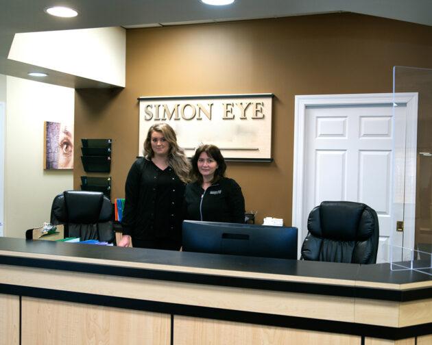 Two staff members of Simon Eye.