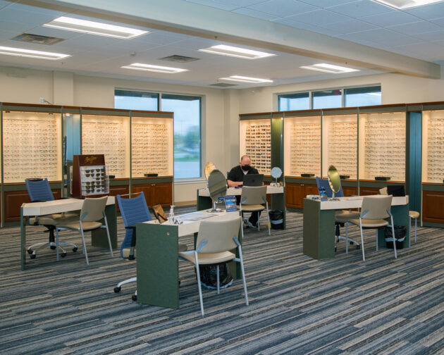 A space in Simon Eye Middletown with desks, chairs, and eyeglasses displays.