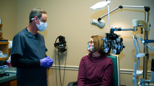 A woman is getting an eye exam.