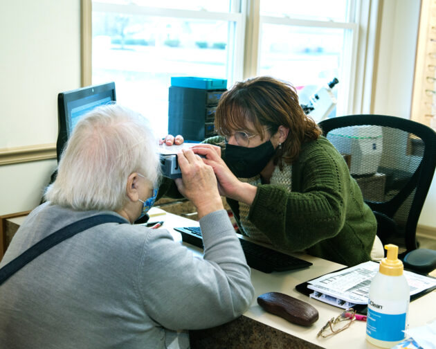 A doctor examining a patient's eyes.