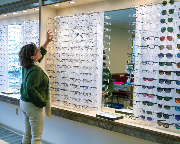 A person browsing a selection glasses on display.