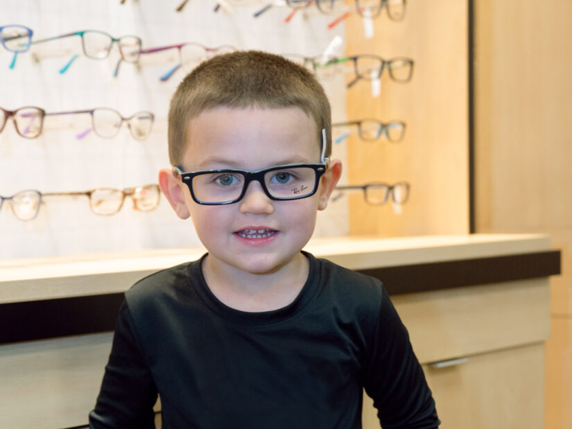 A young boy wearing glasses.