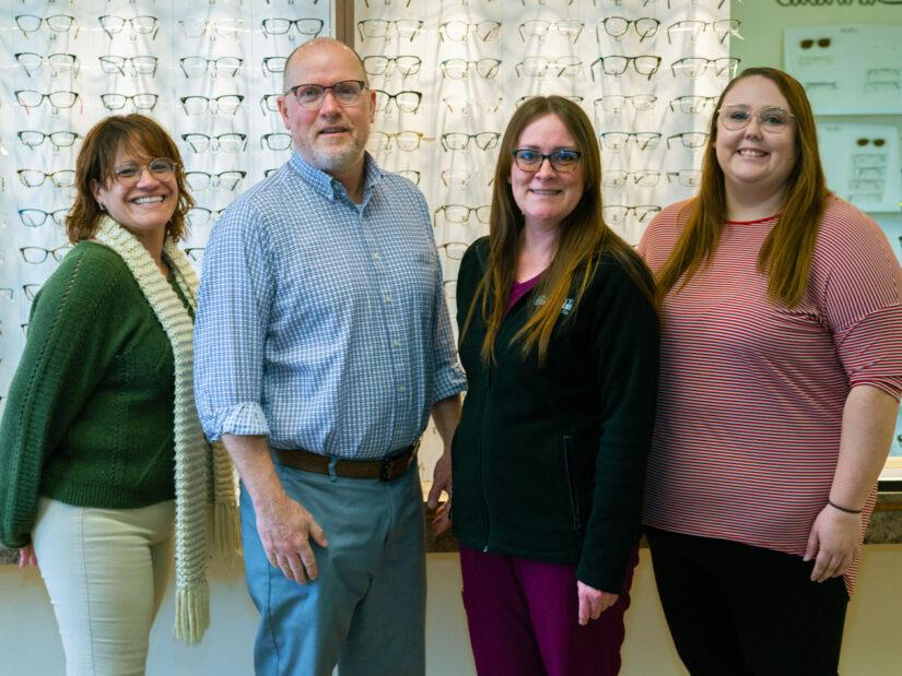 Four people wearing eyeglasses.