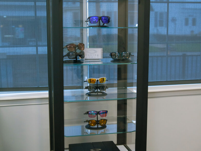 Eight pairs of sunglasses in a display case.