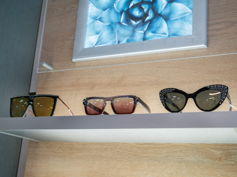 Three pairs of sunglasses on display next to one another.