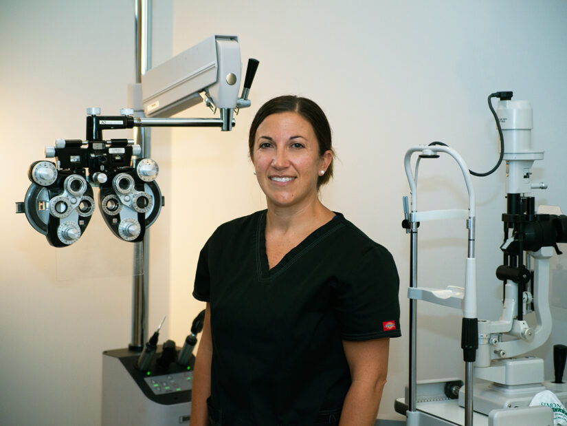 A doctor with eye exam equipment.